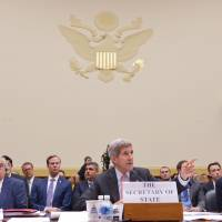 U.S. Secretary of State John Kerry testifies before the House Foreign Affairs Committee on the Iran nuclear agreement on Capitol Hill on Tuesday. Flanking Kerry are Energy Secretary Ernest Moniz (left) and Treasury Secretary Jacob Lew.   AFP-JIJI
