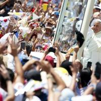 Mass celebrated by pope in Ecuador focuses on family, draws hundreds of thousands