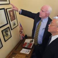 POW-turned-Sen. McCain hosts Hanoi's top Communist