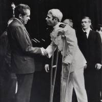 John McCain is greeted by President Richard Nixon in Washington on Sept. 14, 1973. Republican presidential candidate Donald Trump criticized Sen. John McCain's military record at a conservative forum Saturday, saying the party's 2008 nominee and former prisoner of war was a 'war hero because he was captured. I like people who weren't captured.' McCain spent 20 years in the Navy, a quarter of it in a Vietnamese prisoner of war camp after his jet was shot down over Hanoi during a bombing mission Oct. 26, 1967. McCain on Monday urged Trump to apologize to military families. | AP
