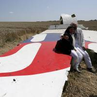 A year after Flight MH17 was shot down over Ukraine, relatives still wait for answers