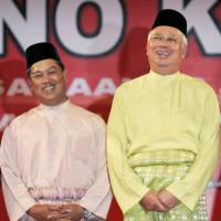 Malaysian Prime Minister Najib Razak (right) and Deputy Prime Minister Muhyiddin Yassin share a light moment in 2009 during an event marking the 63rd anniversary of the United Malays National Organization in Kuala Lumpur.   REUTERS