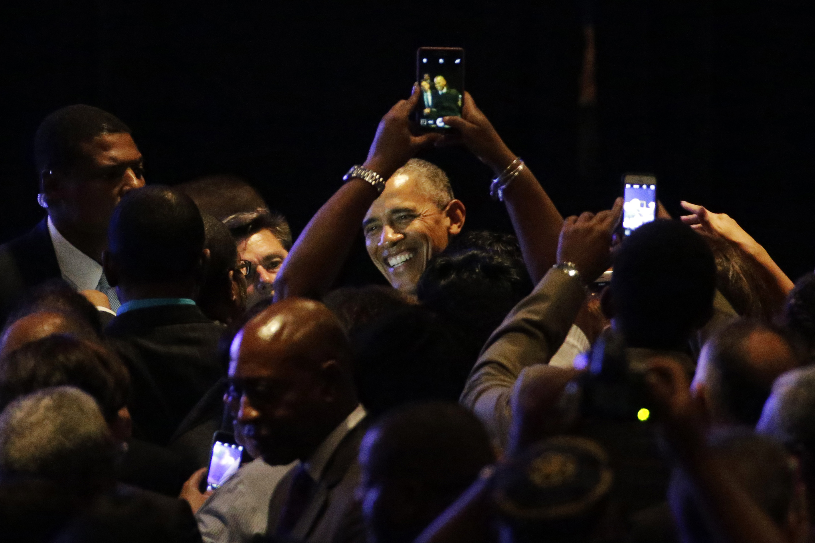 President Barack Obama poses for photographs with the crowd after speaking during the NAACP's 106th Annual National Convention Tuesday in Philadelphia. | AP