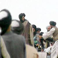 A file picture taken in Kandahar on an undisclosed date in 1996 shows a TV screengrab of footage taken secretly by BBC Newsnight that claims to show the Afghan Taliban's one-eyed leader Mullah Mohammed Omar (center) during a rally for his troops in Kandahar, before their victorious assault on Kabul.   AFP-JIJI / BBC TV / NEWSNIGHT