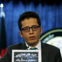 Syed Zafar Hashemi, a deputy spokesman for Afghanistan President Mohammad Ashraf Ghani, speaks during a news conference in Kabul Wednesday, when Afghanistan said Taliban leader Mullah Omar died in 2013.   REUTERS