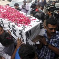 Relatives carry the coffin of Saulat Mirza after his body arrived in Karachi in May. Mirza was hanged after an anti-terrorism court sentenced him to death in 1999 for killing three people. | REUTERS