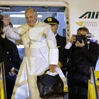Pope heads home to Rome after urging youth in Paraguay to help their peers, seek dignity