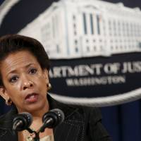 U.S. Attorney General Loretta Lynch speaks at a news conference at the Justice Department in Washington about the shootings at a Charleston, South Carolina church, in this June 18 file photo. Dylann Roof, who was charged in South Carolina with the murders of nine African-Americans at a historic Charleston church last month, will face federal hate crime charges, media outlets reported Wednesday. | REUTERS