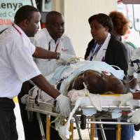 A man wounded during an attack on a residential complex in Soko Mbuzi village of Mandera town at the Kenya-Somalia border is wheeled on a stretcher as he arrives at the Kenyatta National Hospital in Nairobi Tuesday. | REUTERS
