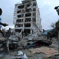 Al-Shabab suicide truck bomb breaches blast walls of Somali's most secure hotel; eight killed