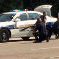 In this image made from video and released by WRCB-TV, authorities work an active shooting scene on the Amincola highway near the Naval Reserve Center, in Chattanooga, Tennessee, on Thursday. Chattanooga Mayor Andy Berke says police were pursuing an active shooter after reports of a shooting at the military reserve center.   WRCB-TV VIA AP