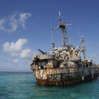 The Sierra Madre transport ship of the Philippines navy lies grounded on the disputed Second Thomas Shoal, in the Spratly Islands. Several marines live on the vessel, turning it into a military outpost asserting Manila's claim to those waters in the South China Sea. | REUTERS