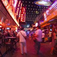 Bangkok's Soi Cowboy entertainment district — one of the red-light areas in the city — in seen through a fisheye lens in June 2012. | ISTOCK