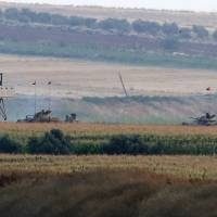 Turkish army tanks hold positions near the border with Syria, in the outskirts of the village of Elbeyi, east of the town of Kilis, in southeaster Turkey, Thursday. Suspected Islamic State militants fired at a Turkish military outpost from a region under its control, inside Syrian territory Thursday, killing a Turkish soldier and wounding two others, an official said. Turkish troops retaliated.   AP
