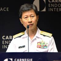 Adm. Tomohisa Takei, the highest ranking officer in the Maritime Self-Defense Force, speaks at a think tank on Wednesday in Washington. | KYODO