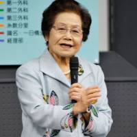 Toshiko Shimabukuro, a former nursing unit member for the Imperial Japanese Army during the Battle of Okinawa, retired in March from working as a storyteller of wartime history. | KYODO
