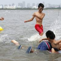 Tokyo opens city's first swimming beach since 1960s
