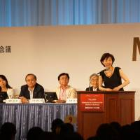 Kaori Sasaki, founder of ewoman Inc., delivers opening remarks at the International Conference for Women in Business at a Tokyo hotel on Sunday.   FUMIHIKO OWAKI