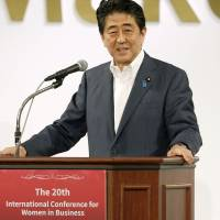 Prime Minister Shinzo Abe speaks at the International Conference for Women in Business on Sunday in Tokyo. | KYODO