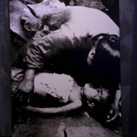 A picture showing a mother holding her son after being bombed by the Japanese Imperial Army in Wuhan, China, is displayed at the Museum of the War of Chinese People's Resistance Against Japanese Aggression, near the Marco Polo Bridge, on the outskirts of Beijing on Tuesday. | REUTERS
