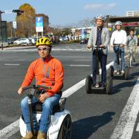 A wheelchair-type vehicle based on Segway technology is given an open-road test in Tsukuba, Ibaraki Prefecture, last Nov. 7. | KYODO