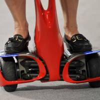 The wheels of a Winglet mobility device manufactured by Toyota Motor Corp. are seen during a demonstration in Tokyo on Aug. 1, 2008. | BLOOMBERG