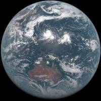 An image taken Tuesday morning by the Himawari-8 weather satellite shows three typhoons south of the Japanese archipelago.   METEOROLOGICAL AGENCY / KYODO