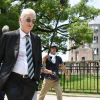 Legendary Led Zeppelin guitarist Jimmy Page visits Hiroshima Peace Memorial Park on Thursday, his first visit to the city since 1971. | KYODO