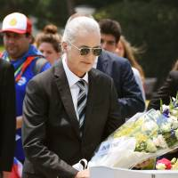 Led Zeppelin's Jimmy Page visits Hiroshima on Thursday and lays flowers at the memorial cenotaph to atomic bomb victims in Hiroshima Peace Memorial Park. | KYODO