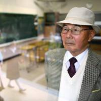Ri Dong Yol, a former teacher at a Korean school providing elementary and secondary education in Matsuyama, Ehime Prefecture, stands in a classroom at the school in April. | KYODO