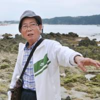 Shuden Teruya visits Nago, Okinawa Prefecture, in June. Teruya owns land used for the U.S. Kadena Air Base, but refuses to sign a lease agreement.   KYODO