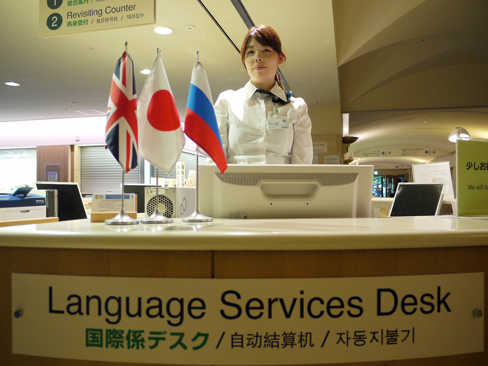 Maya McDonald tends the international desk at St. Luke's International Hospital in Tokyo's Chuo Ward. The facility  handles 1,800 to 2,000 visits by non-Japanese patients every month.   TOMOKO OTAKE