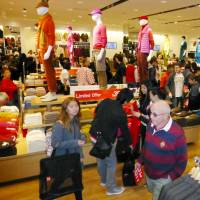 Business is thriving at the Uniqlo clothing outlet in Melbourne, the company's first Australian store, which opened on April 16, 2014. | KYODO
