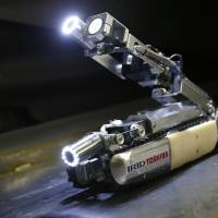 A robot developed by Toshiba Corp. is demonstrated at its laboratory in Yokohama Tuesday. As Japan struggles in the early stages of a decades-long cleanup of the Fukushima nuclear crisis, Toshiba developed the robot, which raises its tail like a scorpion and collects data, to hopefully locate some of the melted fuel in the stricken reactor 2. | AP