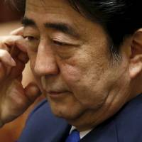 Prime Minister Shinzo Abe attends a session of a Lower House special committee on security legislation at the Diet in Tokyo on Wednesday. | REUTERS