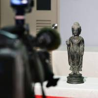 A Buddhist statue stolen by South Korean thieves is shown to the media Saturday on the island of Tsushima, Nagasaki Prefecture, after it was handed over to Japan the previous day. | KYODO