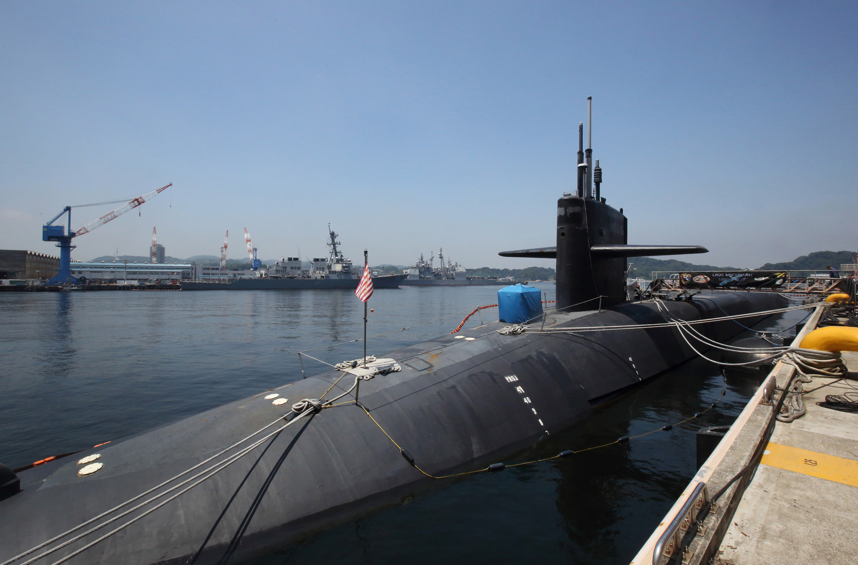 The nuclear-powered submarine USS Michigan is docked at the Yokosuka Naval Base in Kanagawa Prefecture on July 10. | BLOOMBERG