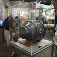 This Monday photo shows a visitor to the Bradbury Science Museum in Los Alamos, New Mexico. examines a replica of 'the gadget.' The gadget was the atomic bomb tested at the Trinity Test Site on July 16, 1945. Thursday marks the 70th anniversary of the Trinity Test.   AP