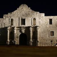 John Potter, a member of the San Antonio Living History Association, patrols the Alamo mission in 2013 in San Antonio, Texas, during a predawn memorial ceremony to remember the 1836 Battle of the Alamo and those who fell on both sides. The San Antonio Missions in Texas have been awarded world heritage status by the U.N.'s cultural body. UNESCO's World Heritage Committee approved the listing Sunday of the five Spanish Roman Catholic sites built in the 18th century in and around what is now the city of San Antonio. | AP