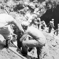 Okinawans are rescued from a cave in an unspecified location in this photo taken by the U.S. military in June 1945. | COURTESY OF OKINAWA PREFECTURAL ARCHIVES / KYODO