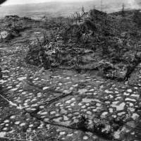 Bullet holes dot the ground at an unspecified location in Okinawa in this photo taken in 1945 by the U.S. military. | COURTESY OF OKINAWA PREFECTURAL ARCHIVES / KYODO