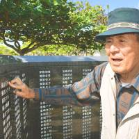 Shinsho Kuniyoshi recalls how eight members of his family died in Saipan during the war from mass murder-suicide or poor health after being taken prisoner, during a November 2014 interview in Itoman, Okinawa Prefecture, by the Cornerstone of Peace. | KYODO