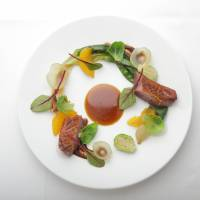 In orbit: The seared pork entree at Difference includes high-quality Shinshu pork from Nagano Prefecture with fresh greens, Brussels sprouts and slices of fruit. | © DIFFERENCE