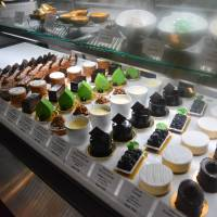 The lineup: Cakes and sweets in rows under the counter. | J.J. O'DONOGHUE