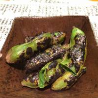 For starters, broad beans are charcoal-grilled in their soft, jade-green pods. | ROBBIE SWINNERON