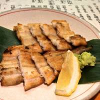 A specialty of the house: delicate fillets of conger eel seared over charcoal. | ROBBIE SWINNERON