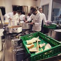 No more excuses: Chef Yoshihiro Narisawa (left) works on a recipe with Massimo Bottura (right front) at Refettorio Ambrosiano, a soup kitchen project set up in Milan to highlight the issues of food waste and global hunger.