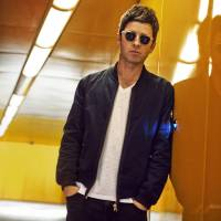 Don't look back in anger: Noel Gallagher misses elements of his old band, Oasis, but admits that his new group, Noel Gallagher's High Flying Birds, allows him experiment more in his songwriting.