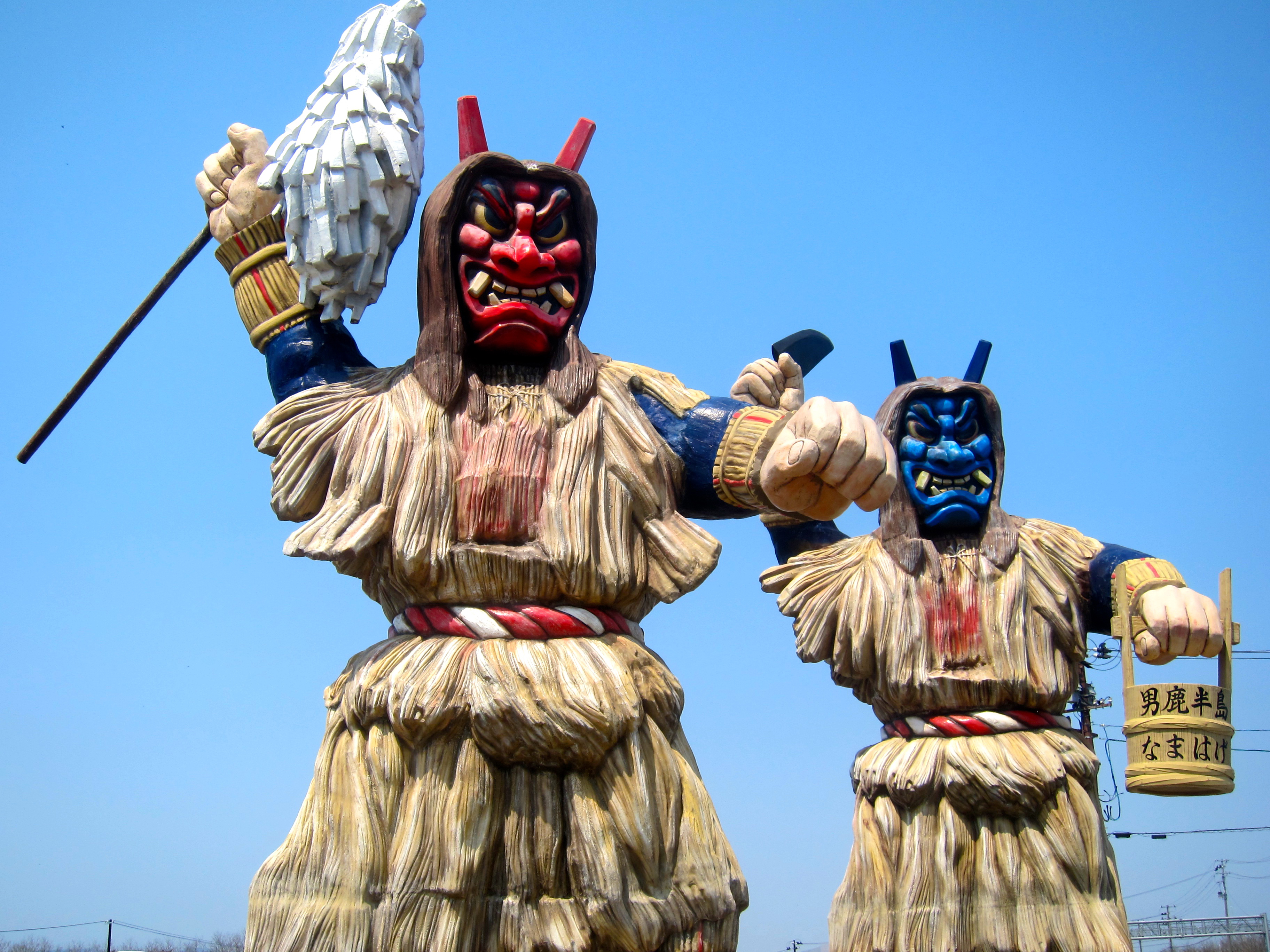 Monumental monsters: The Namahage ogres at the Oga Tourism Center welcome visitors to the Akita prefectural city. | LOUISE GEORGE KITTAKA