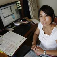 Helping others: Sayaka Osakabe founded Matahara Net, a support group for pregnant women who experience bullying at their workplaces. The word 'matahara' is short for 'maternity harassment.' | REUTERS